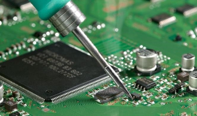 PCB assembly services | a PCB being repaired